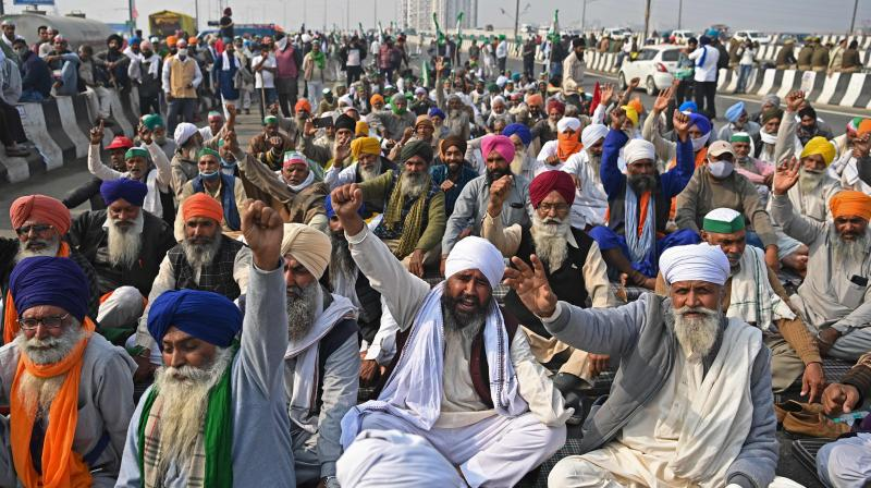 Farmers shout slogans during a protest against the central government's recent agricultural reforms at the Delhi-Uttar Pradesh state border in Ghazipur on December 5, 2020. (AFP)