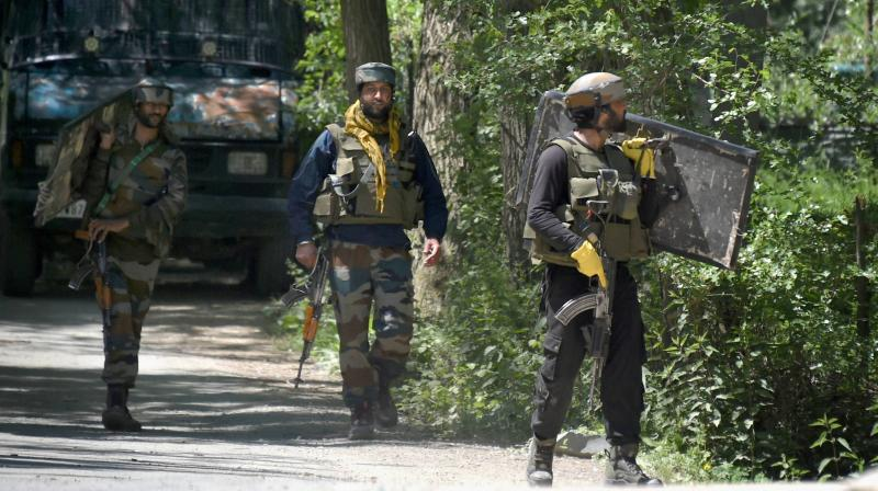 Army soldiers during an encounter with militants at Baigpora area in Pulwama district of South Kashmir on May 6, 2020. Hizbul Mujahideen commander Riyaz Naikoo was killed in an operation by security forces. (PTI)