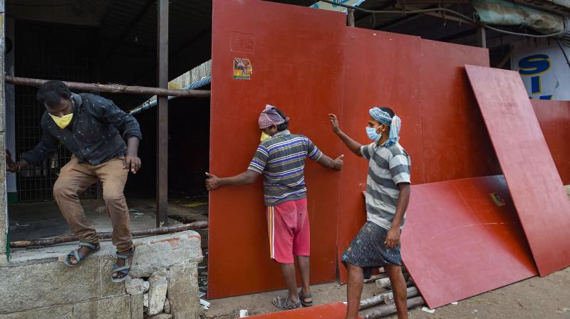 Workers board up a part of the Koyambedu market in Chennai after the surge of coronavirus cases there. (PTI)