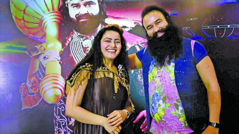 In this file photo Honeypreet Insan is seen with Gurmeet Ram Rahim Singh at the promotional event. (Photo: PTI)
