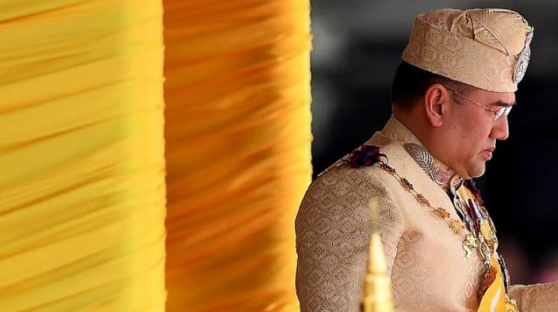 In a ceremony steeped in pomp and centuries of tradition, the 47-year-old Sultan, dressed in gold-coloured traditional Malay formal wear, took the oath of office in the national palace in Kuala Lumpur. (Photo: AFP)
