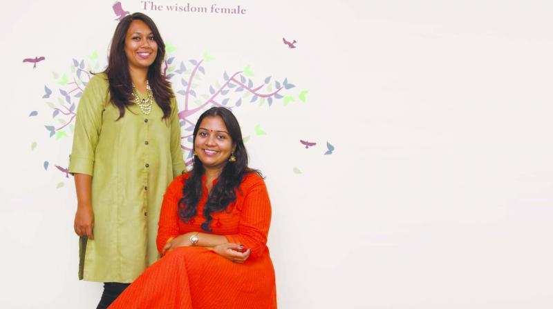 Vandhana Ramanathan (sitting) and Jinal Patel (standing)
