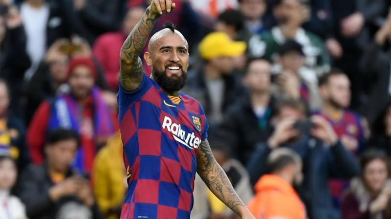 Midfielder Arturo Vidal's decision to sue Barcelona over a dispute about bonus payments will not affect his standing in the team, coach Ernesto Valverde said. (Photo:AFP)