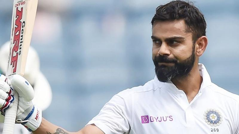Indian captain Virat Kohli on Saturday strongly opposed the 'four-day Test' proposed by the ICC as he is not in favour of any alterations which hurts the sanctity of the traditional five-day format. (Photo:AFP)