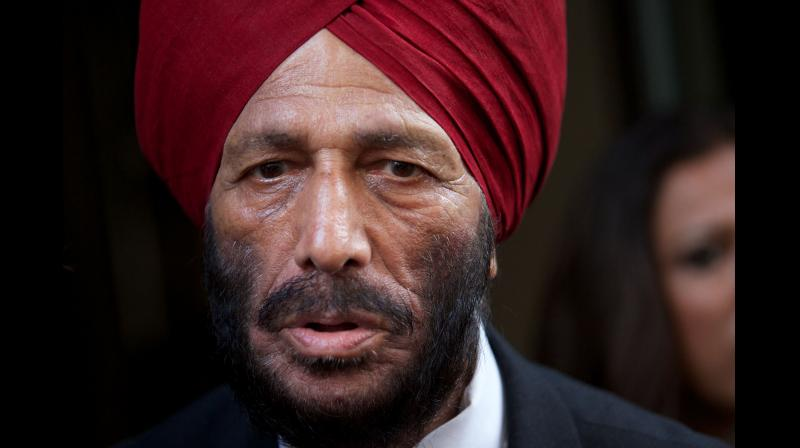 former Indian track and field sprinter Milkha Singh arrives for the gala screening of his life story, the Bollywood Film 'Bhaag Milkha Bhaag', in central London. - Milkha Singh, one of India's most successful track athletes who overcame childhood tragedy to seek Olympic glory, has died aged 91 after a long battle with Covid-19, Indian media said on June 18, 2021. (AFP File)