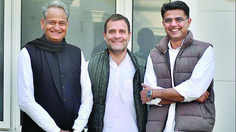 Congress president Rahul Gandhi with Rajasthan Congress president Sachin Pilot and party leader Ashok Gehlot at his residence in New Delhi. (Photo: PTI)