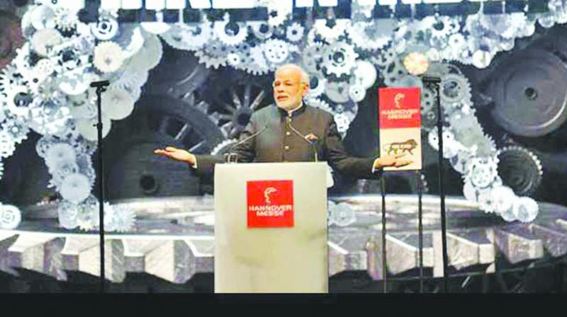 A file photo of Prime Minister Narendra Modi speaking at the opening of the 2015 industrial fair in Hanover, Germany.