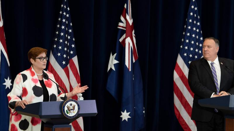 US Secretary of State Mike Pompeo listens while Australia's Foreign Minister Marise Payne speaks during a press conference at the US Department of State following the 30th AUSMIN July 28, 2020, in Washington, DC. (AFP)
