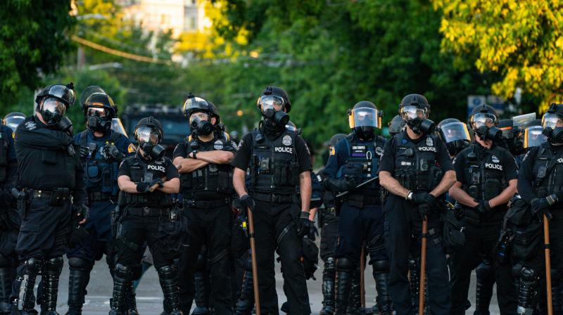 Police block a road during protests near the Seattle Police East Precinct on July 26, 2020 in Seattle. (AFP)