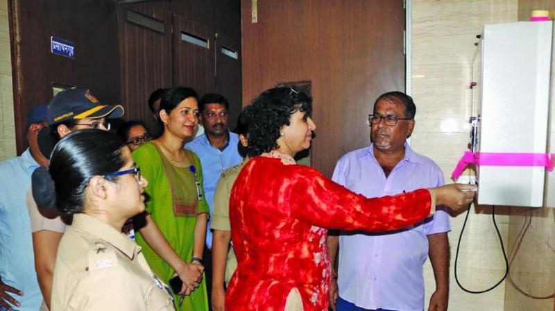 Mrs Sharmila Barve inaugurating the first sanitary vending machine