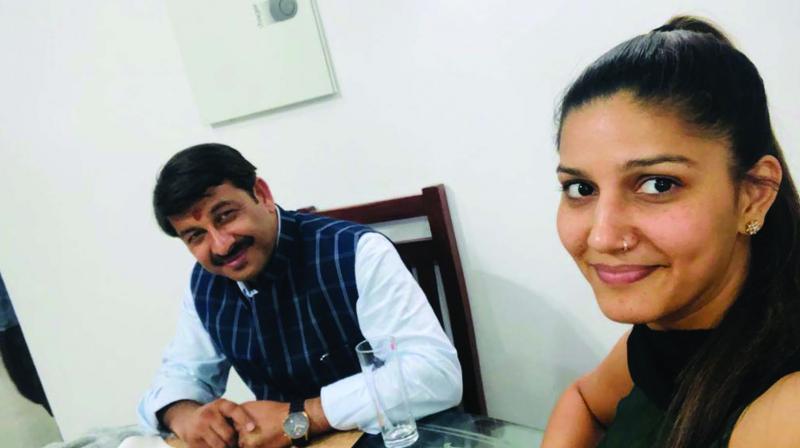 Delhi BJP president Manoj Tiwari with folk singer Sapna Chaudhary.
