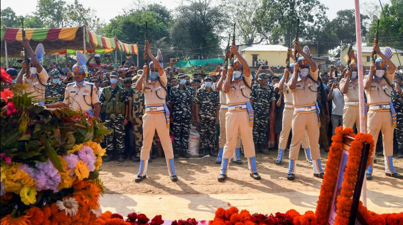Security personnel pay tribute to CRPF jawan Shambhu Roy, who died in a gun battle with Maoist rebels in Chhattisgarh, during his funeral ceremony at Dharmanagar in North Tripura district on April 6, 2021. (PTI)
