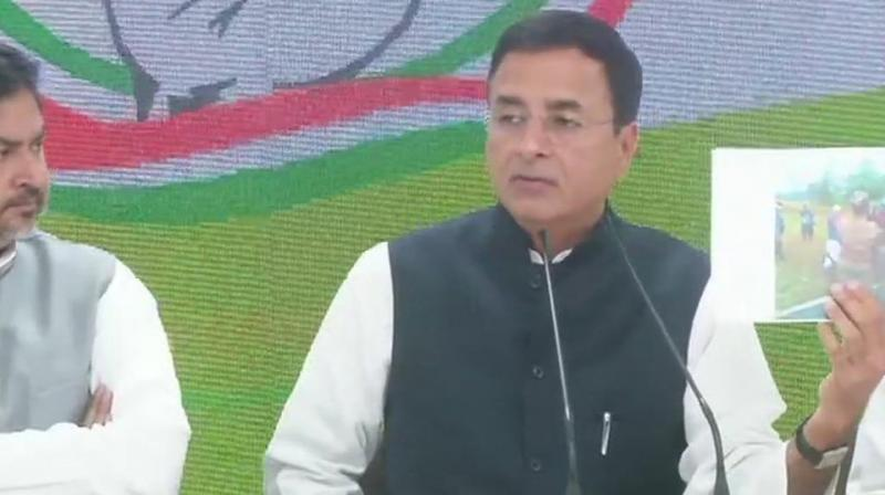 Congress spokesperson Randeep Surjewala, addressing a press conference, launched an all-out attack on the government and the prime minister over the Pulwama terror strike. (Photo: ANI | Twitter)