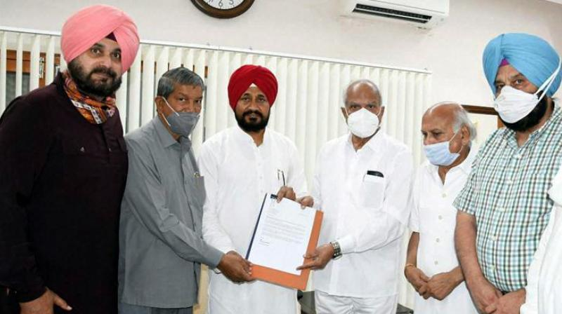 Punjab CM Designate Charanjit Singh Channi submits the letter to Punjab Governor Banwarilal Purohit afte the former was announced as the next CM of Punjab, at Raj Bhavan in Chandigarh, Sunday, Sept. 19, 2021. (PTI Photo)