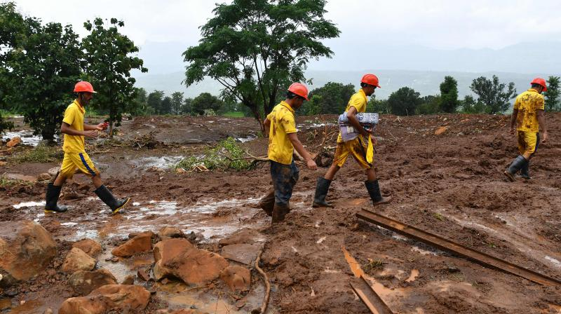 Rescue workers search for victims at the site of a landslide at Taliye, about 22 km from Mahad city on July 24, 2021, as the death toll from heavy monsoon rains climbed to 76, with nearly 90,000 others evacuated in the western state of Maharashtra. (Photo: AFP)