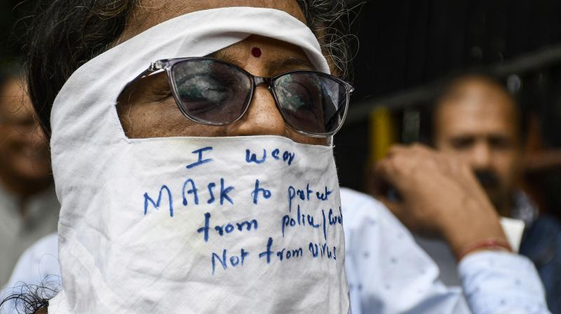 Awaken India Movement activists protest against the government's mandatory mask-and-vaccine policy and demand an end to the lockdown, at Dadar in Mumbai. (Photo: PTI)