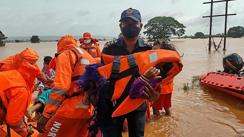 NDRF personnel rescue stranded villagers from flooded areas following heavy monsoon rains in Balinge village of Kolhapur district of Maharashtra. (Photo: Twitter/@NDRFHQ)