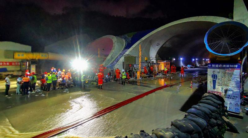 This photo taken on July 15, 2021 shows rescuers working to clear a flooded tunnel after 14 construction workers were trapped in an underground section of a new highway construction site after it collapsed in Zhuhai in China's southern Guangdong province. (Photo: AFP)