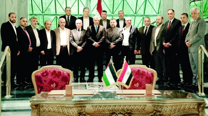 Fatah and Hamas officials after a reconciliation deal is signed during a short  ceremony at the Egyptian intelligence complex in Cairo. (Photo: AP)