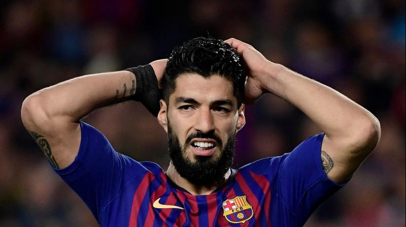 Suarez is unlikely to face Getafe at home in La Liga on Sunday before Barcelona play away to Eibar the following weekend in their last league game of the season. (Photo: AFP)