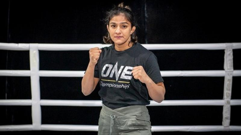 Wrestler Ritu Phogat made a successful Mixed Martial Arts (MMA) debut after defeating South Korea's Nam Hee Kim in the knockout bout at the Cadillac Arena here on Saturday. (Photo:TwitteR)