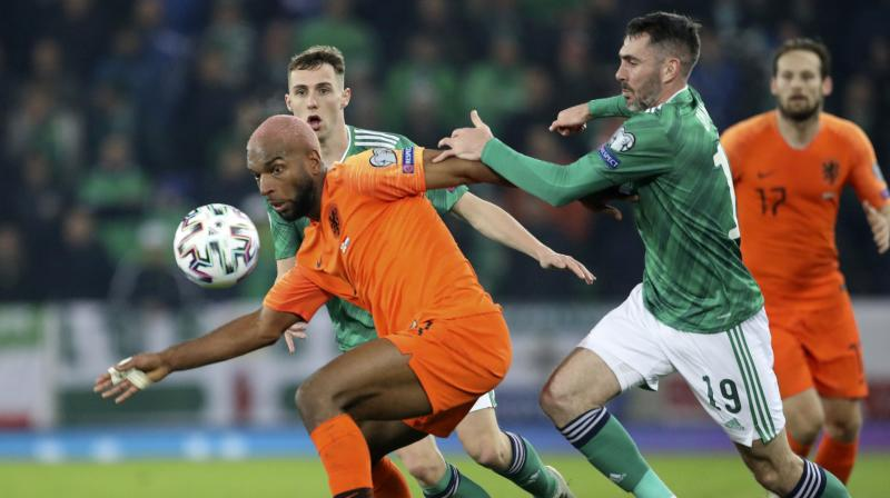 Ryan Babel forced two good saves from Bailey Peacock-Farrell either side of a Promes curler that flashed narrowly wide. Northern Ireland were gifted a golden opportunity to take the lead after 30 minutes when Joel Veltman was ruled to have handled McNair's cross in the area under pressure from George Saville. (Photo:AP)
