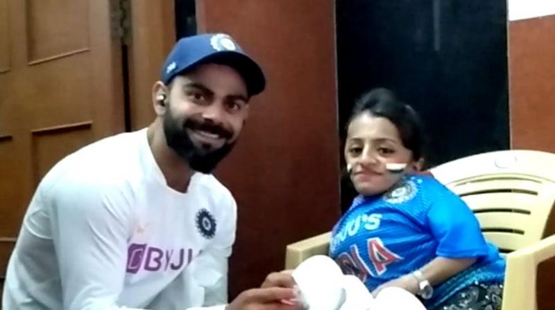 India skipper Virat Kohli after winning the first Test match against Bangladesh by an innings and 130 runs, met with a specially-abled girl Pooja Sharma at Holkar Cricket Stadium here on Saturday. (Photo:Twitter)