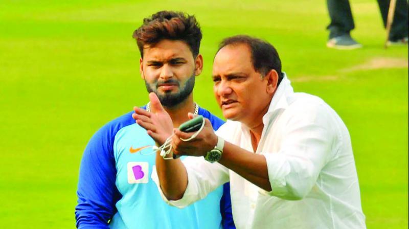 Rishabh Pant is all ears to former India captain Mohammad Azharuddin in Hyderabad on Thursday. (Photo: P Surendra)