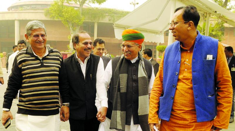 Minister of State for Parliamentary affairs Arjun Singh Meghwal along with Congress leader Adhir Choudhary and others arrives at the Parliament House during the winter session in New Delhi on Thrusday,December 05,2019. (Photo: Pritam Bandyopadhyay)
