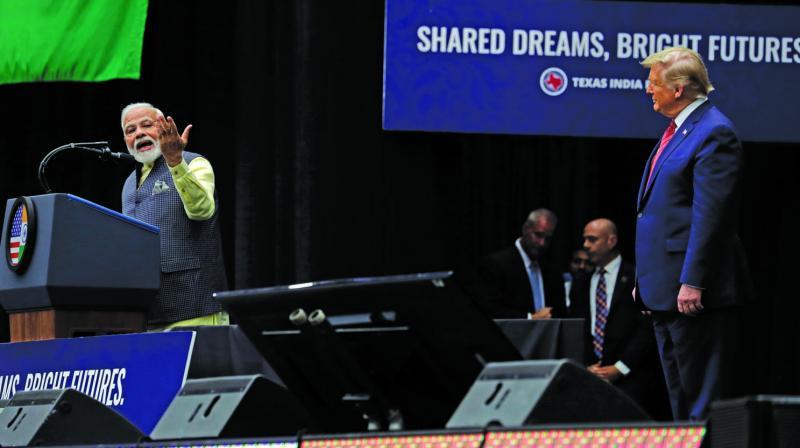 US President Donald Trump looks as Prime Minister Narendra Modi speaks at NRG Stadium, Houston, during the 'Howdy Modi: Shared Dreams, Bright Futures' event on Sunday. (Photo: AP)