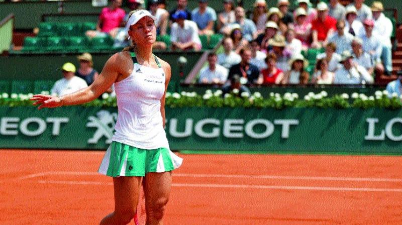 Germany's Angelique Kerber walks away after her 6-2, 6-2 loss to Ekaterina Makarova of Russia in their French Open first round match on Sunday. (Photo: AP)