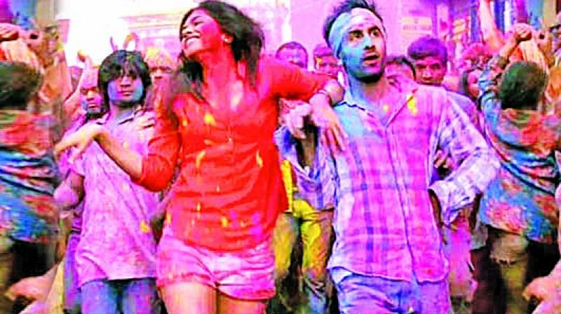 From Deepika Padukone's white shirt and denim shorts in the song 'Balam Pichkari' to Alia Bhatt's colourful skirts and playful tops for the title track of Badri Ki Dulhania and 2 States – fashion can play a really important role in adding a dash of glam for this fun festival.