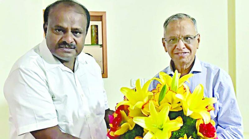 Karnataka chief minister H.D. Kumaraswamy (left) meets Infosys founder N.R. Narayana Murthy in Bengaluru. (Photo: PTI)