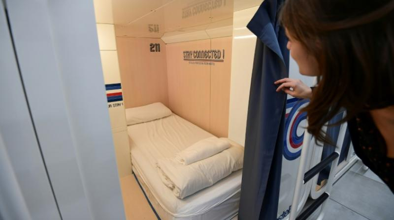 With no-fuss convenience for both the city and transport links, digital connectivity and a social side among their chief selling points, the capsule hotels target the Generation Y crowd. (Photo: AFP)