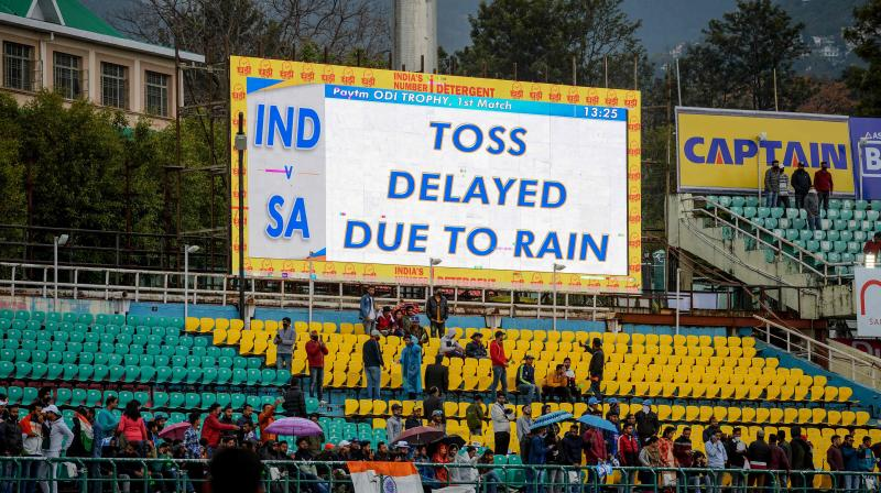 COIN THAT WAS NEVER TOSSED: A giant screen shows that announcement that toss was being delayed due to rain but it turned out that rain forced the abndonment of the first ODI between India and South Africa at Dharamsala on Thursday. AFP Photo