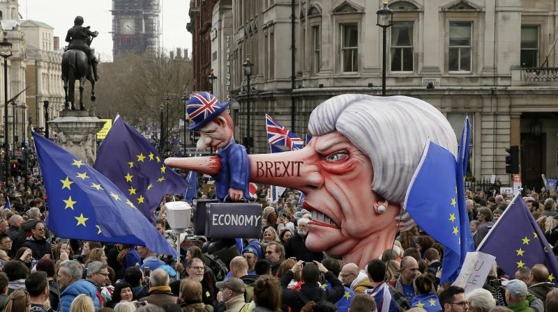 An effigy of British Prime Minister Theresa May is wheeled through Trafalgar Square during a Peoples Vote anti-Brexit march in London. (Photo:AP)