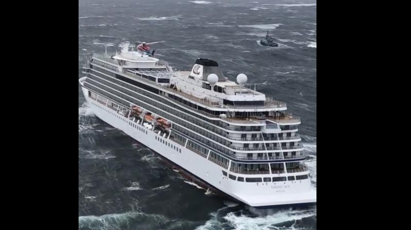 Helicopters fly over the cruise ship Viking Sky after it sent out a Mayday signal because of engine failure in windy conditions. (Photo:AP)