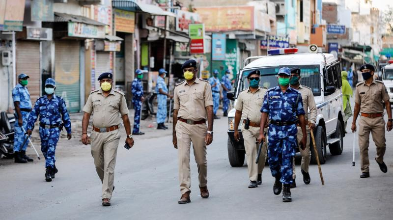 Rapid Action Force (RAF) personnel patrol a street urging people to stay indoors amid a nationwide lockdown in Ahmedabad. PTI photo