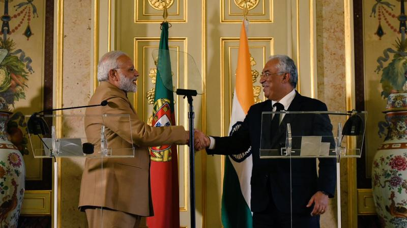 Portuguese Prime Minister Antonio Costa (right) greets Prime Minister Narendra Modi. (Photo: Twitter | @MEAIndia)