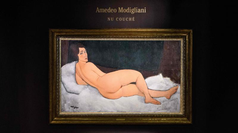 Italian painter and sculptor Amedeo Clemente Modigliani's 'Nu couché (sur le côté gauche)' painting is displayed after its unveiling at the Sothebys auction house showroom in Hong Kong on April 24, 2018.(Photo: AFP)