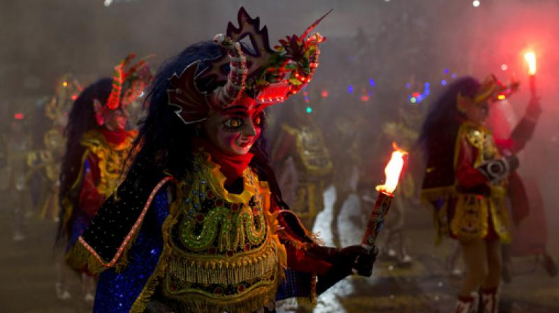 The carnival is a religious festival dating back more than 200 years in an ongoing pagan-Catholic blend of religious practice in the region (Photo: AP)