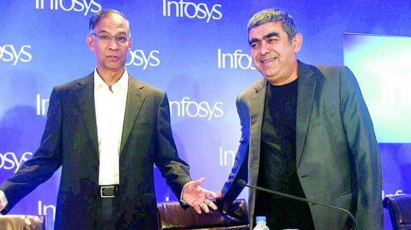 Infosys chairman R. Seshasayee and Infosys CEO Vishal Sikka.