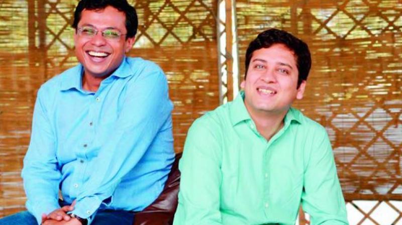 Flipkart Founders Sachin Bansal (L) and Binny Bansal (R).