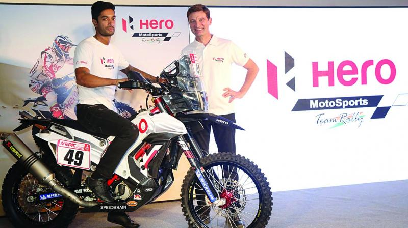 C.S. Santosh (left) at the unveiling of Team Hero Motorsports' RR 450 bike in New Delhi.
