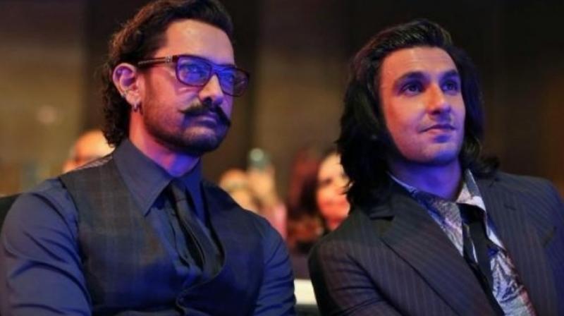 Aamir Khan and Ranveer Singh at an event.