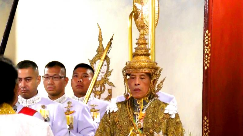 King Maha Vajiralongkorn was crowned with Hindu and Buddhist ritual, vowing to reign