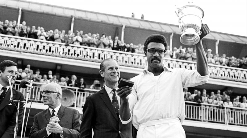 West Indies captain Clive Lloyd holds the 1975 World Cup trophy aloft.