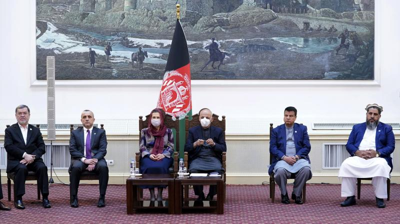 Afghan President Ashraf Ghani, third from right, attends a ceremony of India's AstraZeneca coronavirus vaccination at the Afghan presidential palace in Kabul, Afghanistan, Tuesday, Feb. 23, 2021. (The Presidential Palace via AP)
