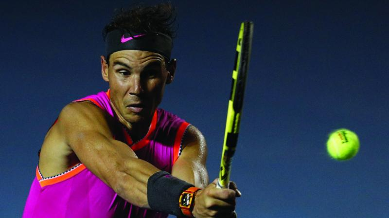 Spain's Rafael Nadal returns a ball in his Mexican Tennis Open round one match against Germany's Mischa Zverev in Acapulco, Mexico on Tuesday. (Photo: AP)