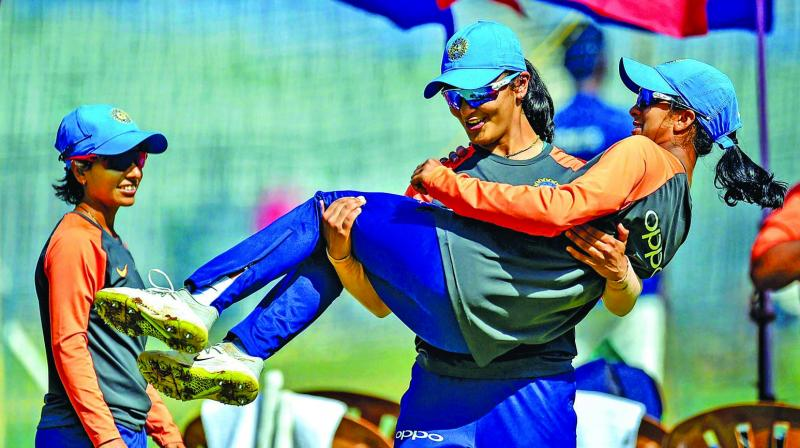 Harleen Deol carries Jemimah Rodrigues as Poonam Yadav looks on during a training  session ahead of the third ODI against England in Mumbai. (Photo: PTI)